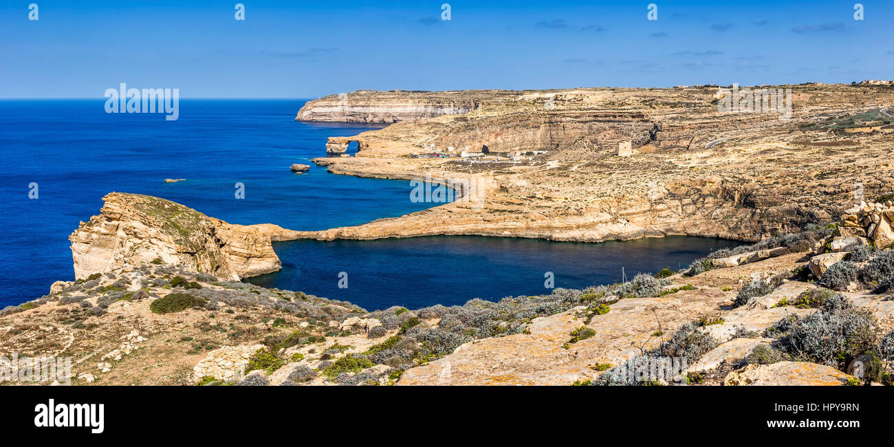 Gozo, Malta - The famous Azure Window with the Fungus rock and Dwejra bay on a beautiful summer day with clear blue - Stock Image