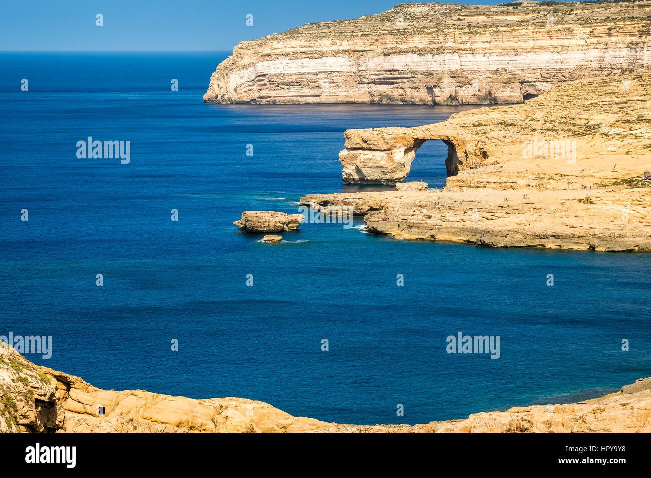 Gozo, Malta - The Azure Window and Dwejra bay on a beautiful summer day with clear blue sky - Stock Image