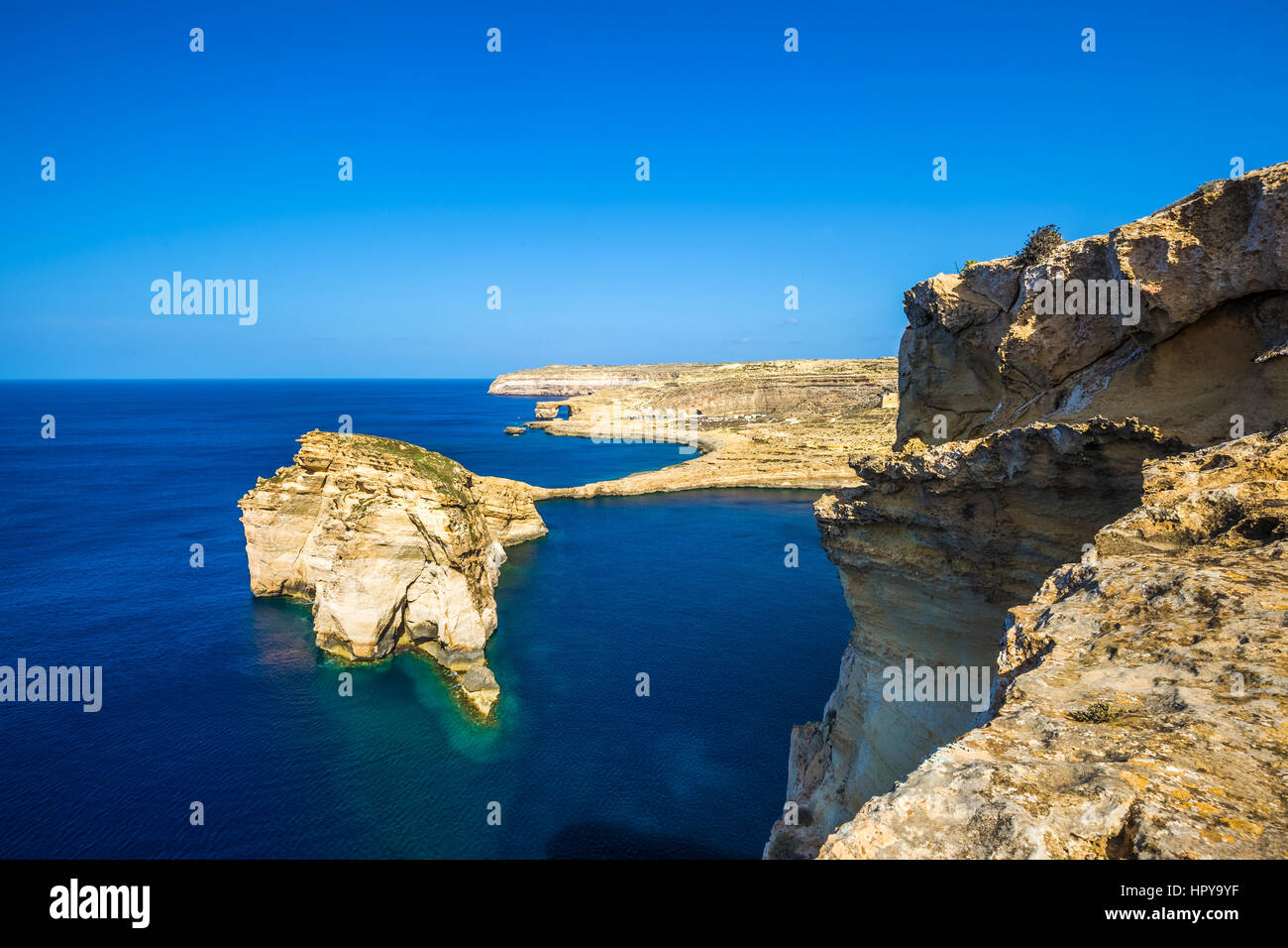 Gozo, Malta - Tha beautiful Fungus Rock on the Island of Gozo with the Azure window at background and clear blue Stock Photo