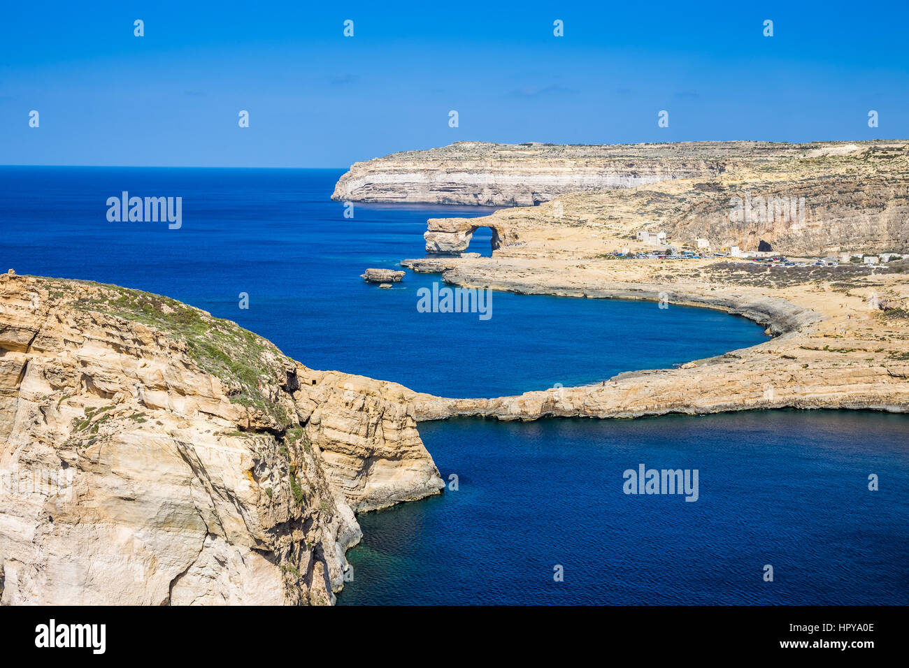 Gozo, Malta - The Fungus Rock and the Azure Window at Dwejra bay on a beautiful summer day with clear blue sky sea Stock Photo