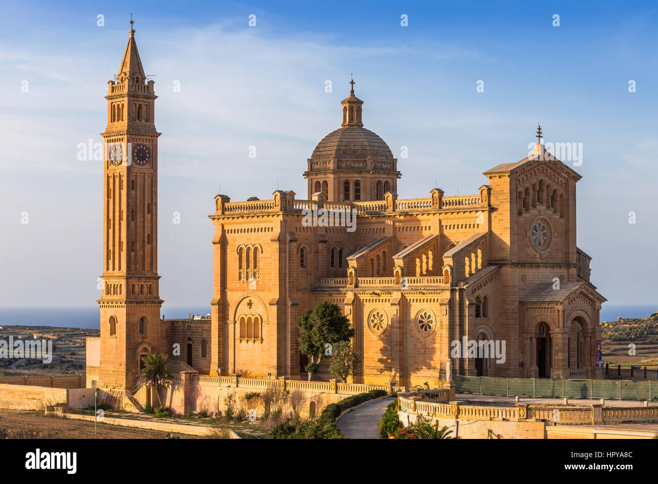 Gozo, Malta - The Basilica of the National Shrine of the Blessed Virgin of Ta' Pinu at sunset with clear blue - Stock Image