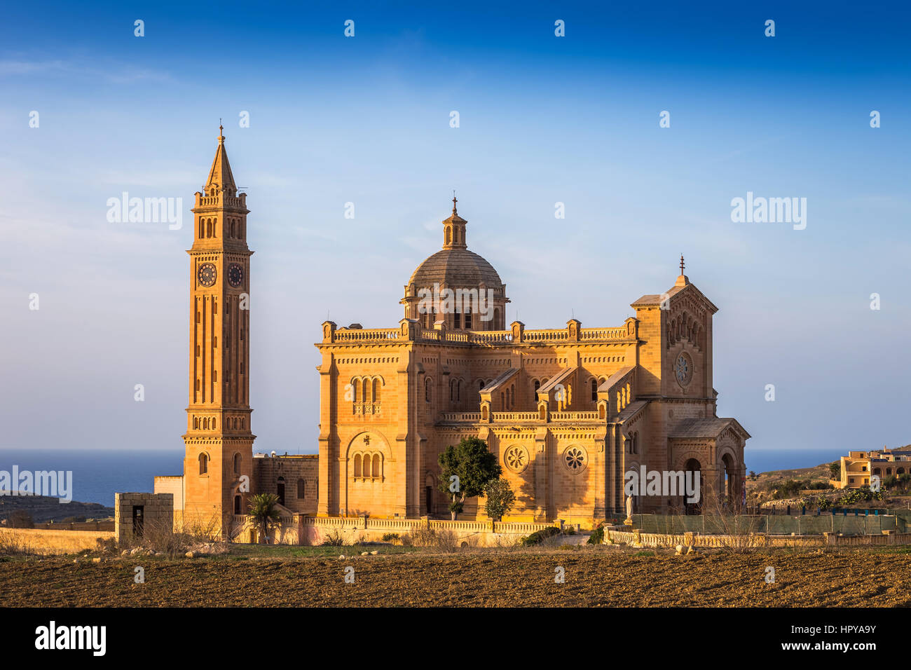 Gozo, Malta - The Basilica of the National Shrine of the Blessed Virgin of Ta' Pinu at sunset with clear blue sky Stock Photo