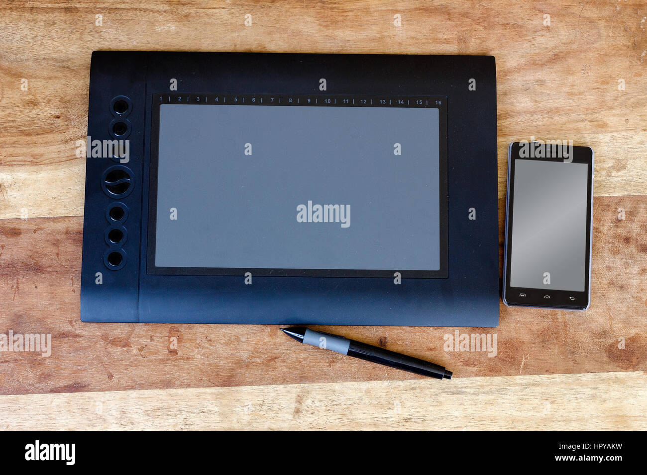drawing tablet and moblie on the wood table Stock Photo