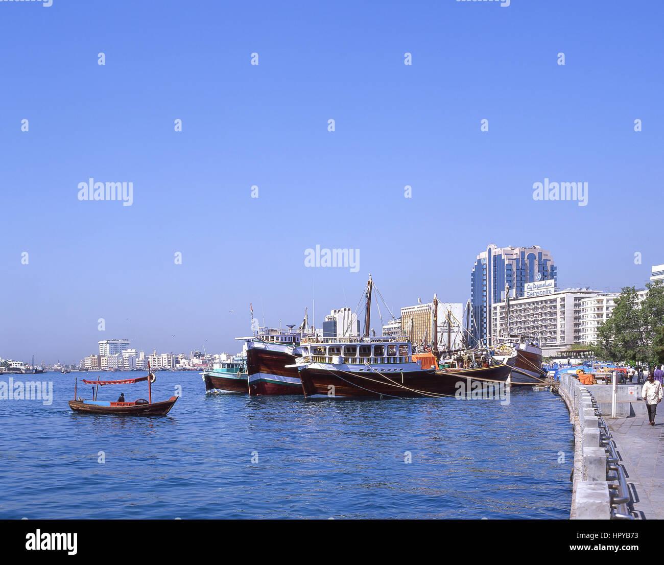 Dhow boats moored on quayside, Dubai Creek, Deira, Dubai, United Arab Emirates Stock Photo