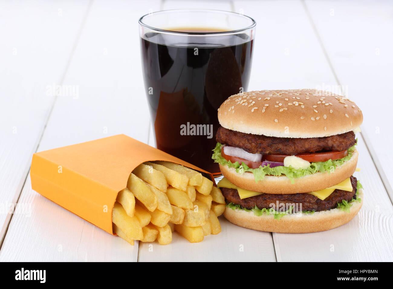 Double burger hamburger and fries menu meal combo cola drink - Stock Image