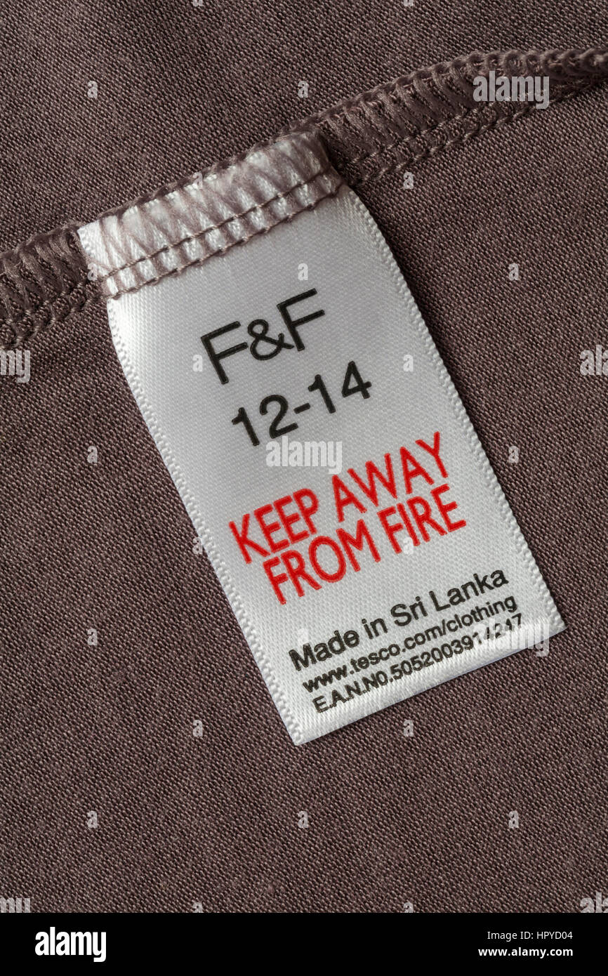 Keep away from fire label in F&F garment size 12-14 for Tesco made in Sri Lanka - sold in the UK United Kingdom, Stock Photo