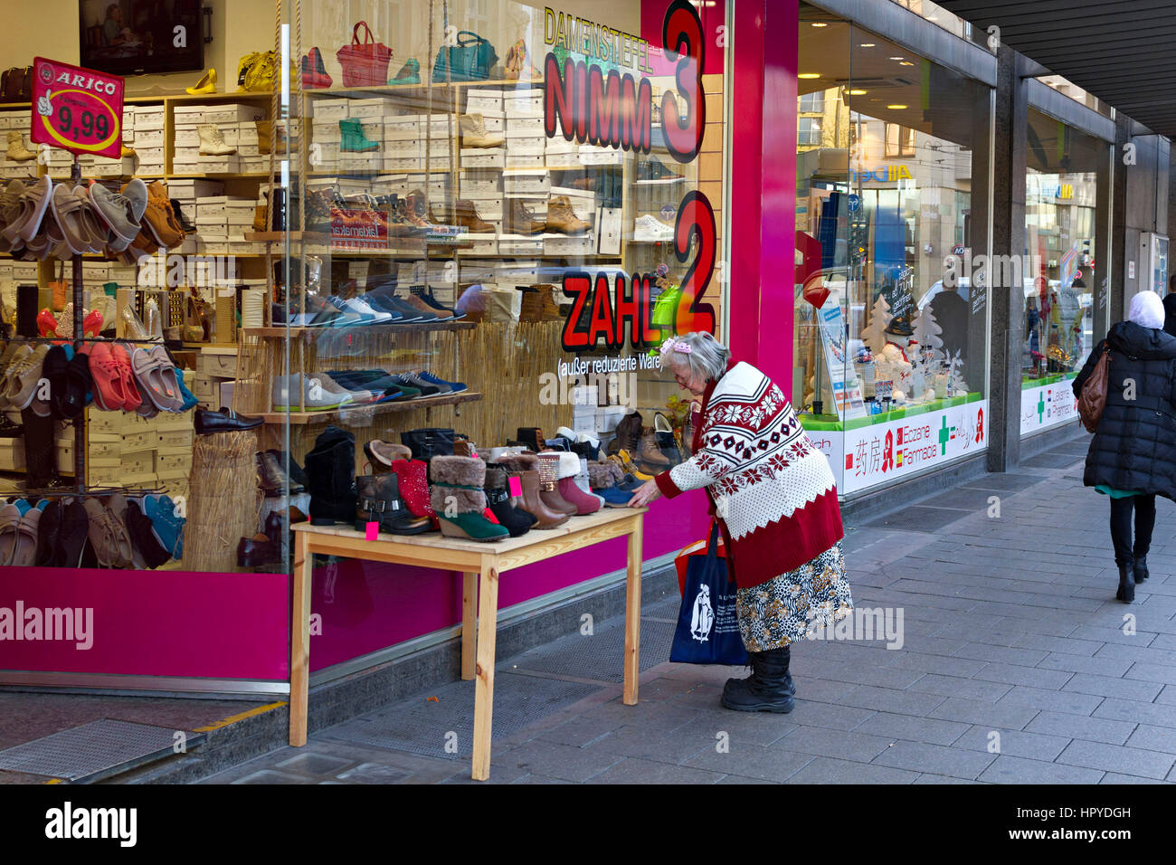 Good Elderly Lady Looking At Reduced Price Shoes Outside A Shoe Shop, Munich,  Upper Bavaria, Germany, Europe