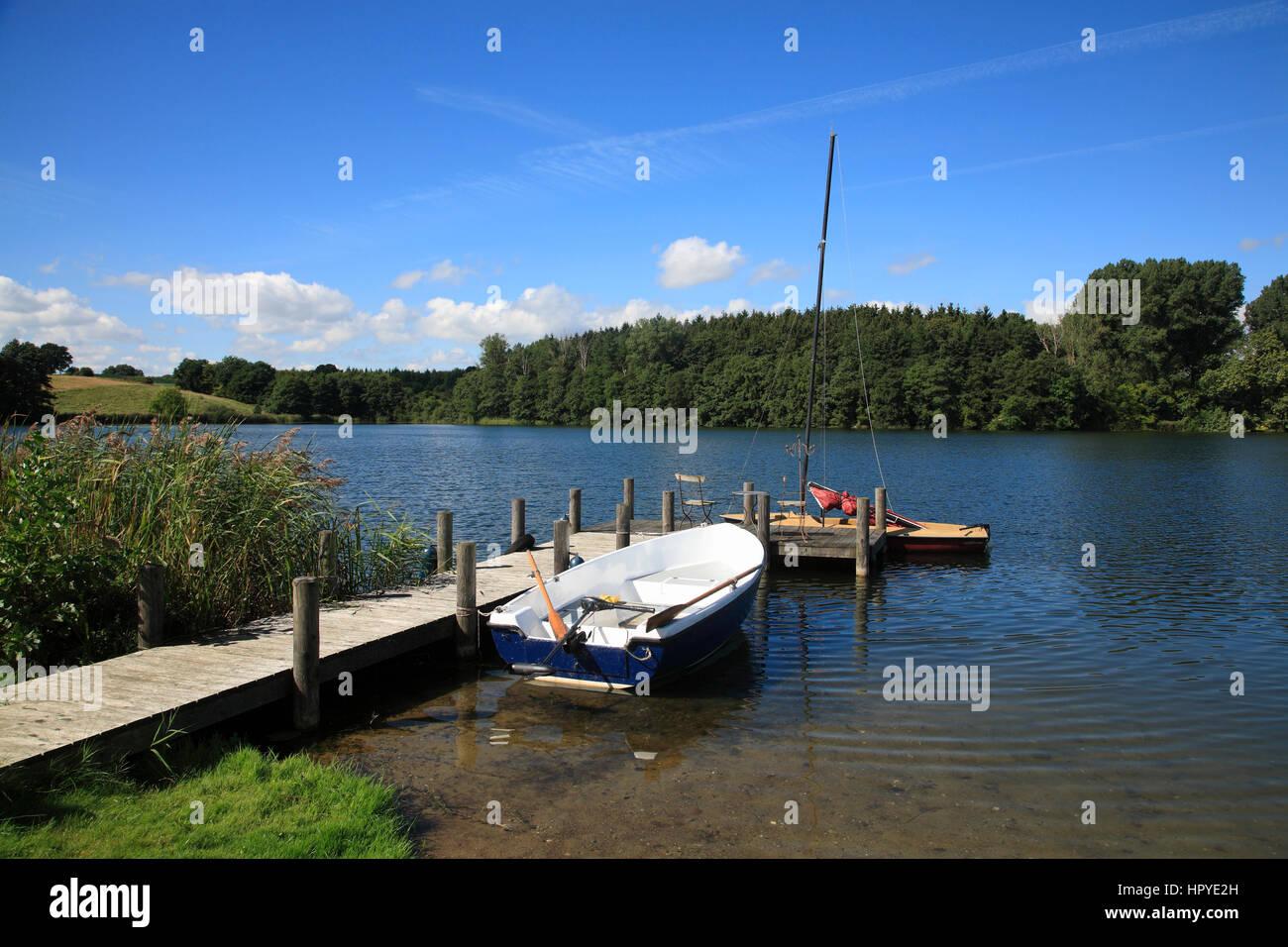 Grebin near Plön, little pier with boats at lake Schierensee, Holsteinische Schweiz, Schleswig-Holstein, Germany, - Stock Image