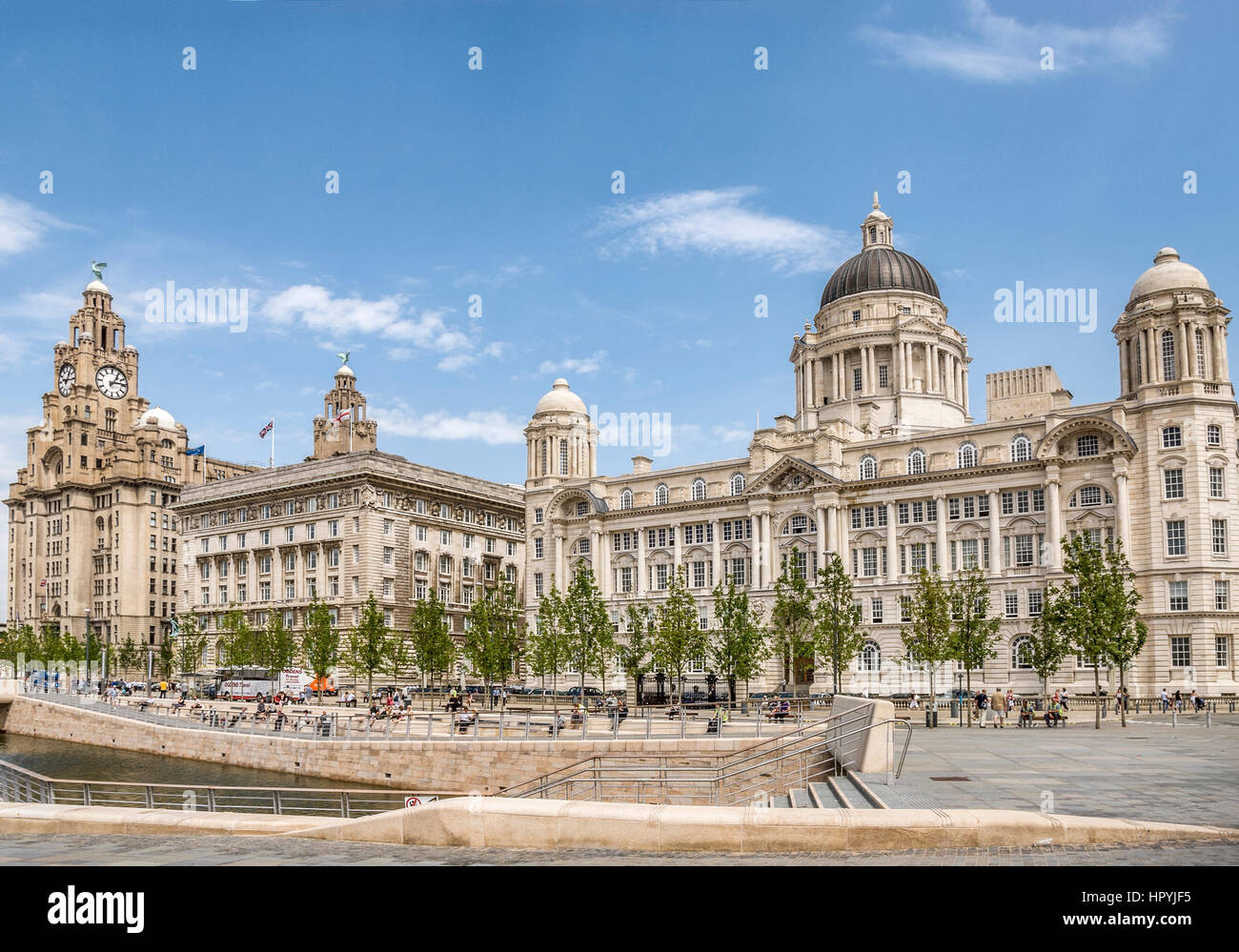 The historic Pier Head riverfront site  in the city centre of Liverpool, England. It encompasses a trio of landmarks, - Stock Image