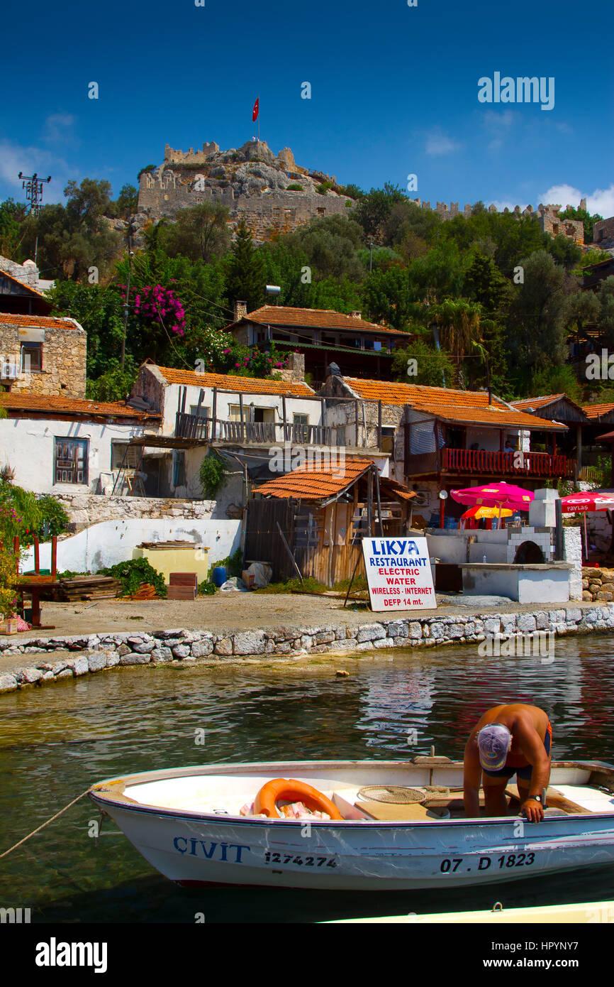 Shoreline and man. Kaleköy. Antalya province. Mediterranean coast. Turkey. - Stock Image