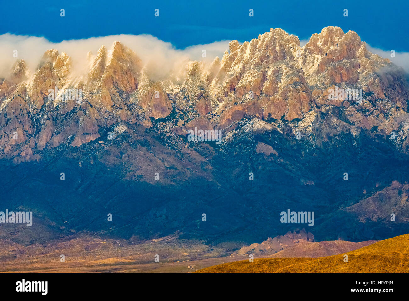 Snow and clouds on Organ Mountain-Desert Peaks National Monument, New Mexico. Formed by executive order by President - Stock Image