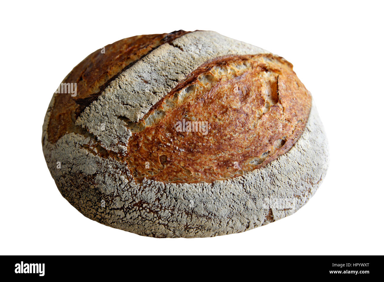 Homemade artisan round white sourdough bread loaf made from natural wild yeast sourdough starter culture. - Stock Image