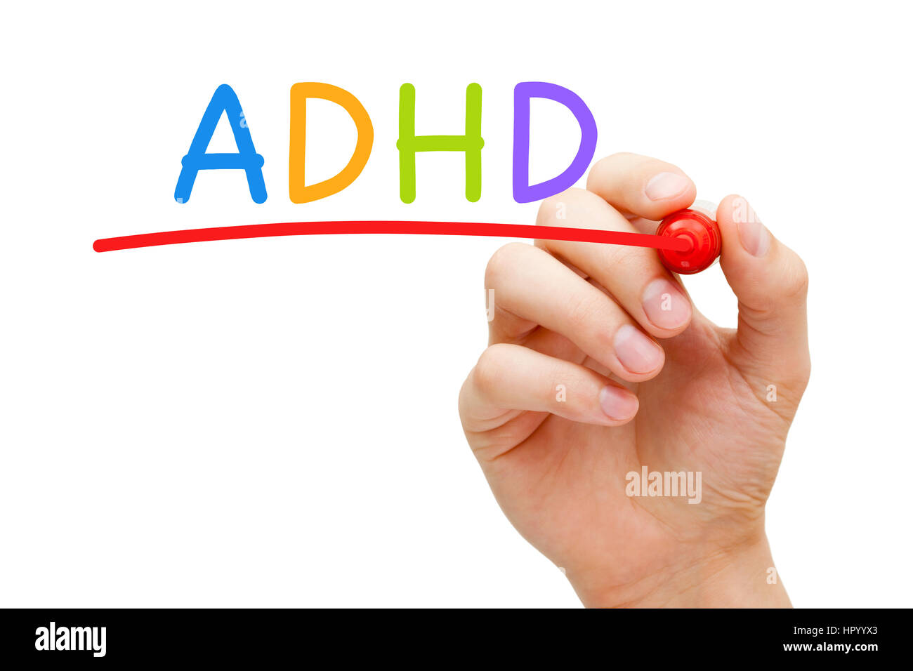 Hand writing ADHD Attention Deficit Hyperactivity Disorder with marker on transparent glass board. - Stock Image