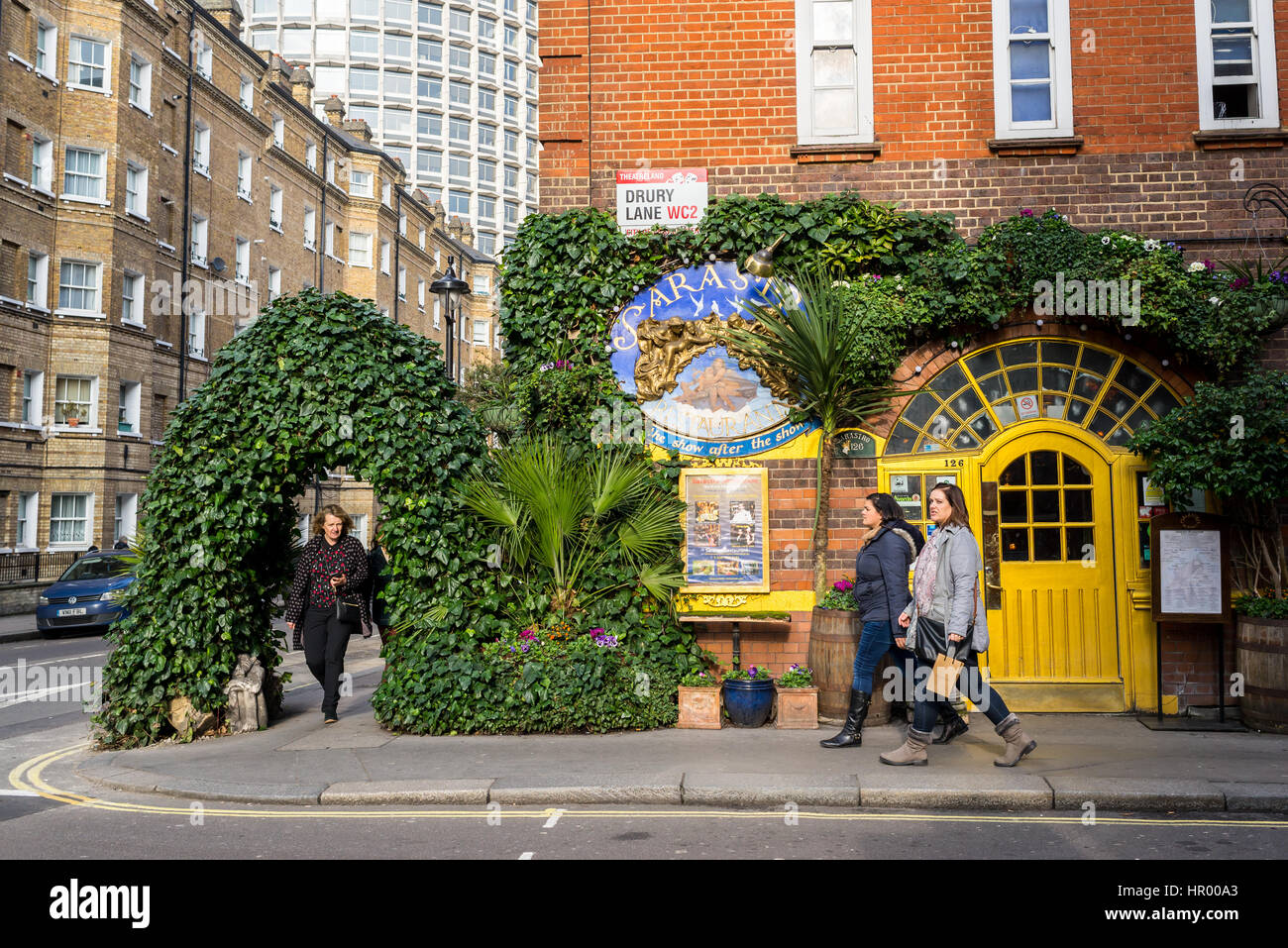 People walking in front of Sarastro restaurant, a Turkish-oriented Mediterranean dining, in Drury Lane, Covent Garden, - Stock Image