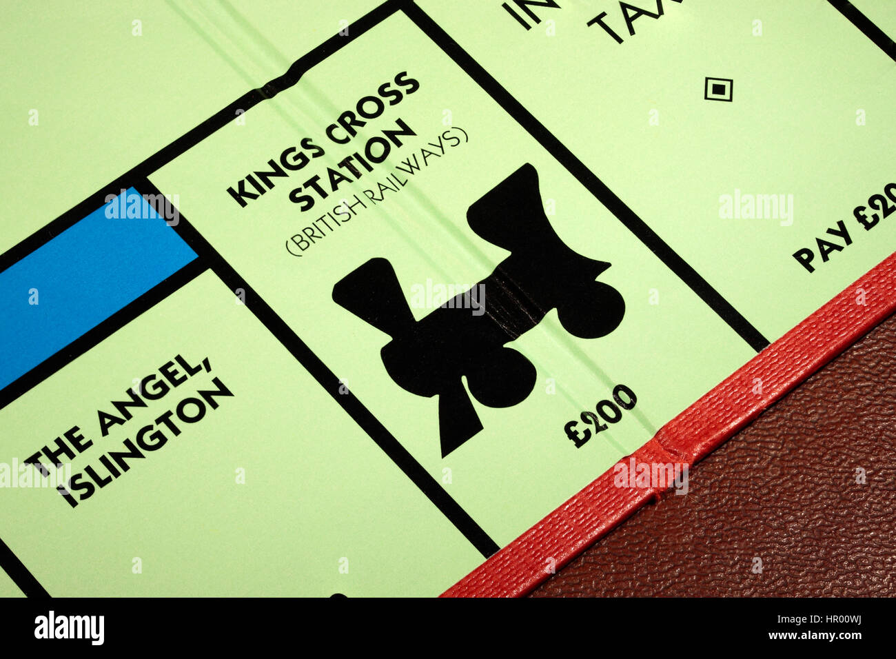 Monopoly board game Kings Cross Station British Railways £200 with The Angel Islington to the left and Income - Stock Image