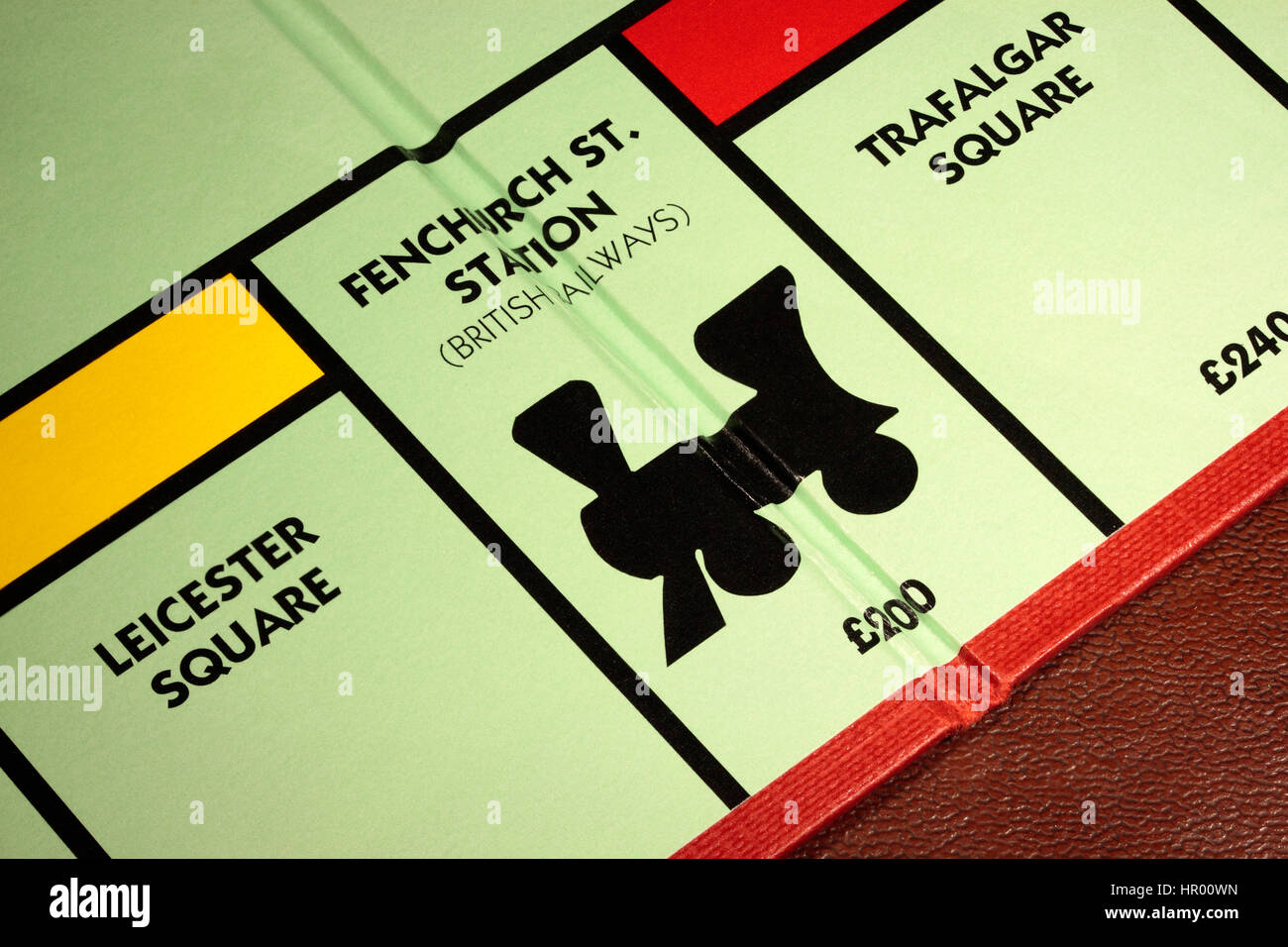 Monopoly board game Fenchurch St. Station British Railways £200 with Leicester Square to the left and Trafalgar - Stock Image