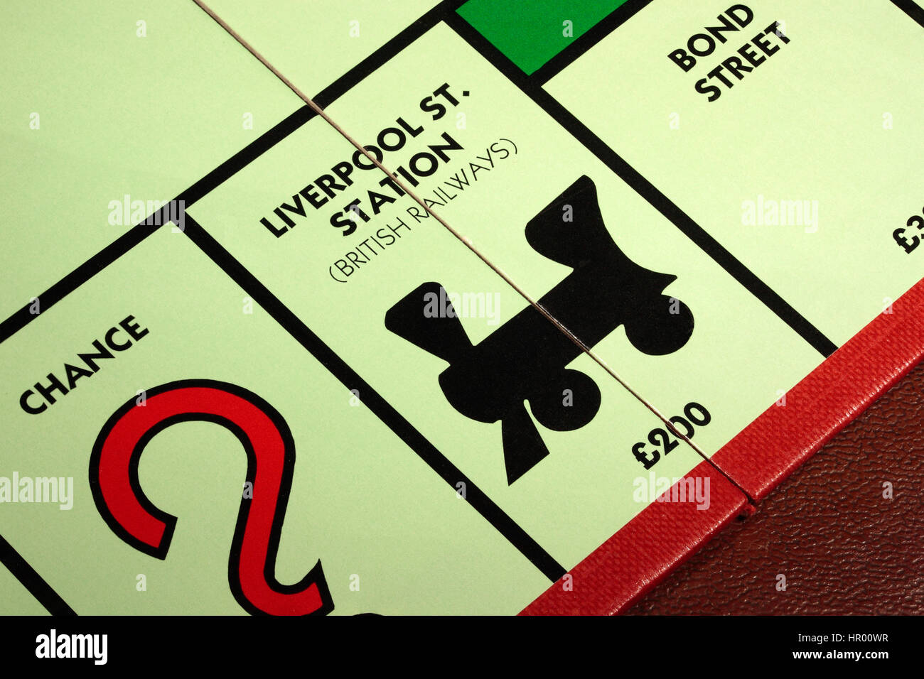 Monopoly board game Liverpool St. Station British Railways £200 with Chance to the left and Bond Street to - Stock Image