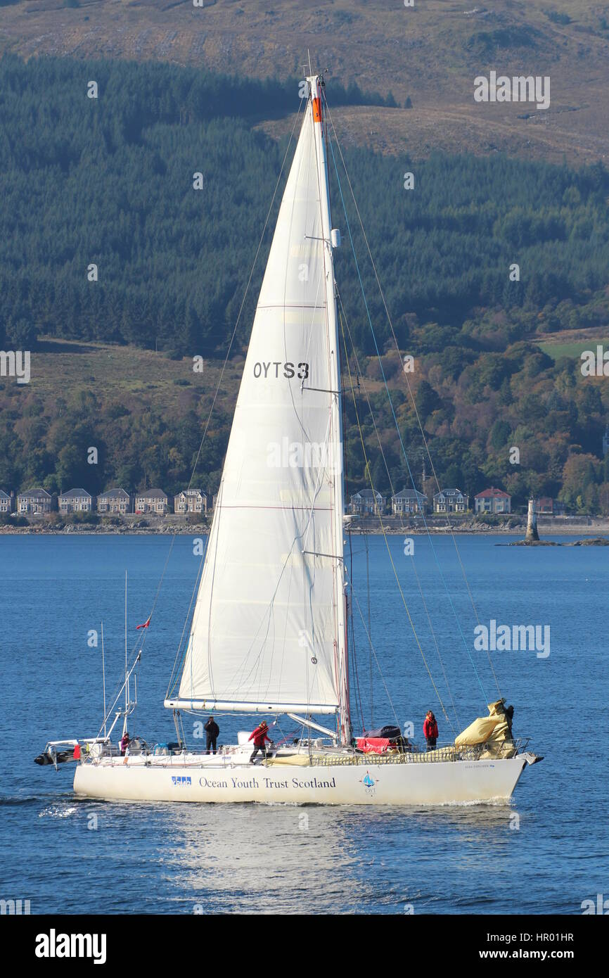 The yacht STV Alba Explorer (OYTS3), operated by the Ocean Youth Trust Scotland, passing Cloch Point on the Firth - Stock Image