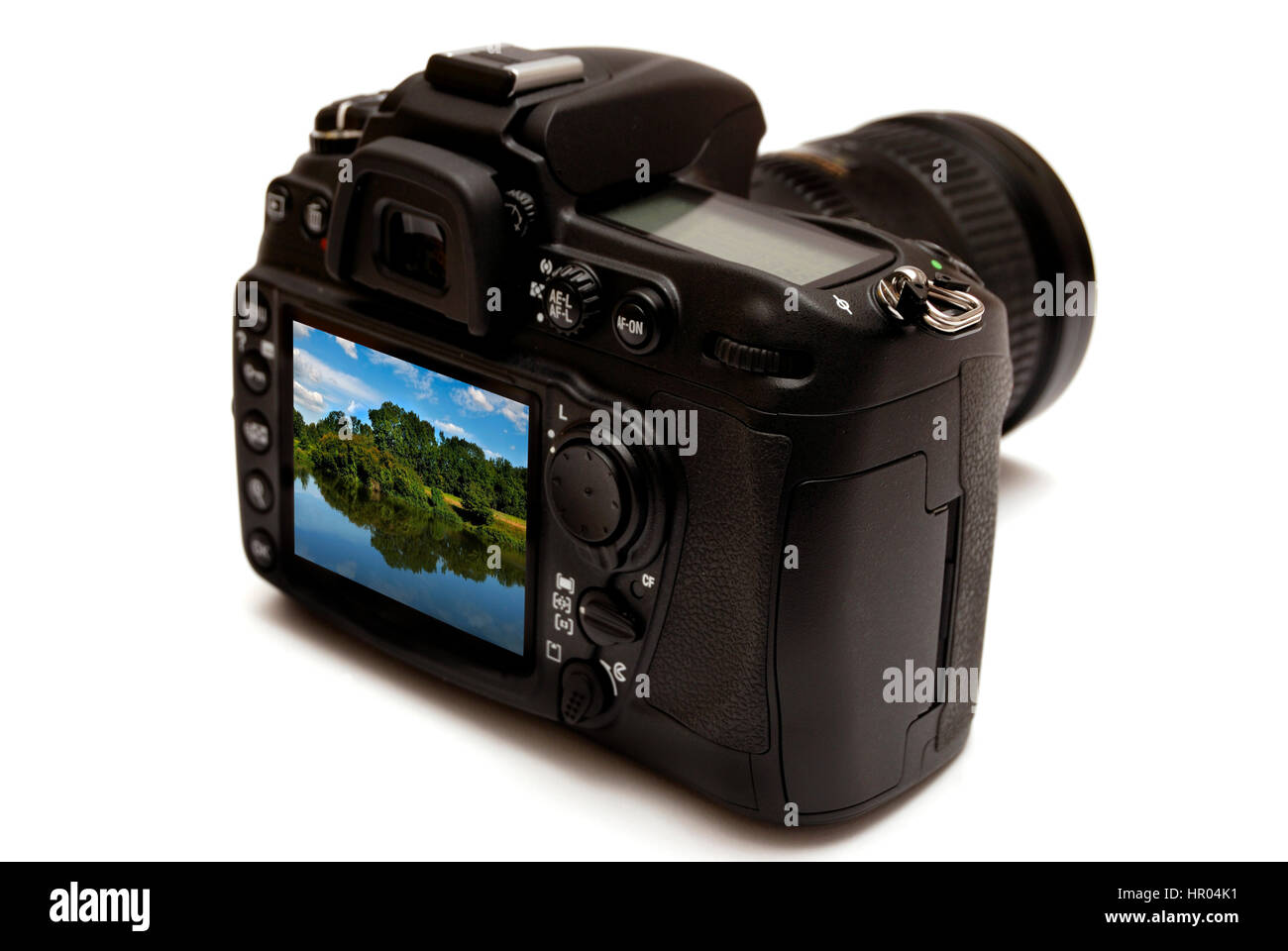 rear view of a digital reflex photo camera isolated - Stock Image