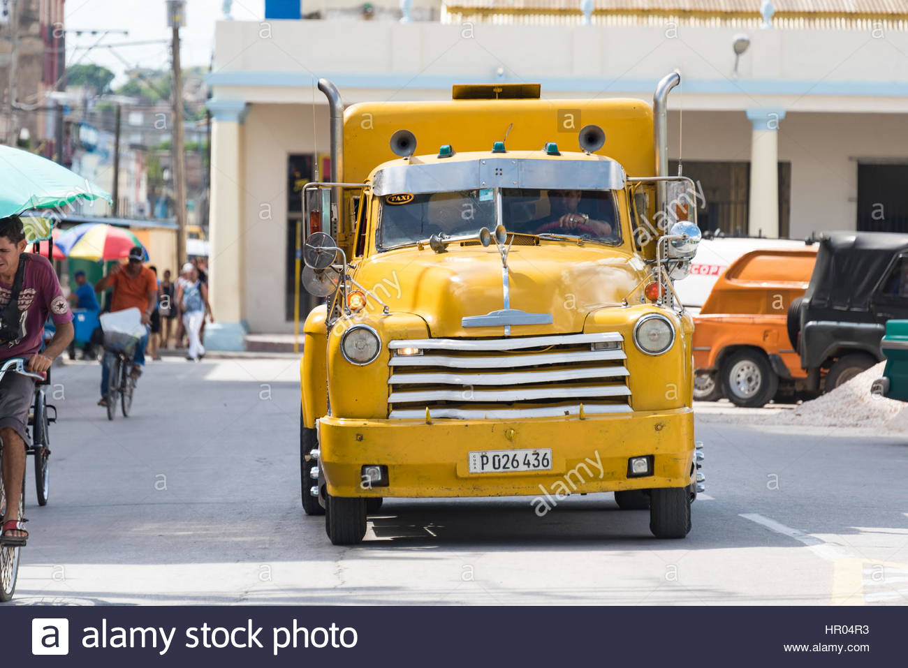 Cuba old yellow Chevrolet vintage truck in action. Economic hardship has forced Cuban people to maintain pre Revolution - Stock Image