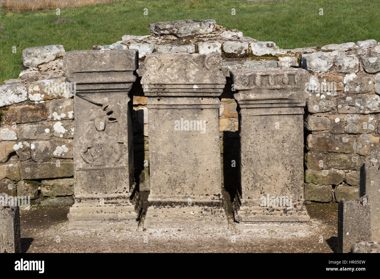 Hadrian's Wall: altars at the remains of the Mithraeum near Carrawburgh (Brocilitia) Roman fort, Northumberland - Stock Image
