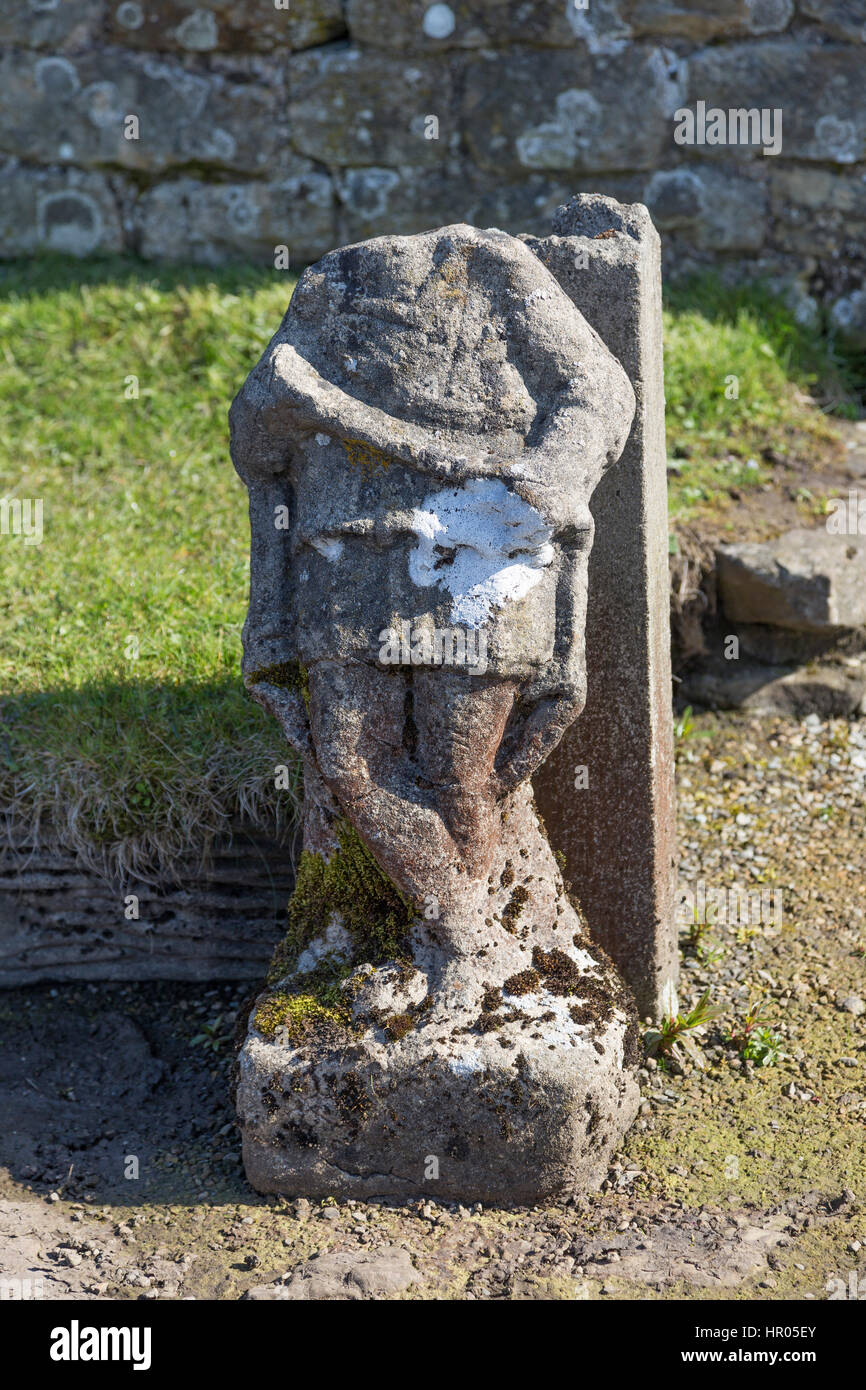Hadrian's Wall: the remains of a statue at the Mithraeum near Carrawburgh (Brocilitia) Roman fort, Northumberland - Stock Image
