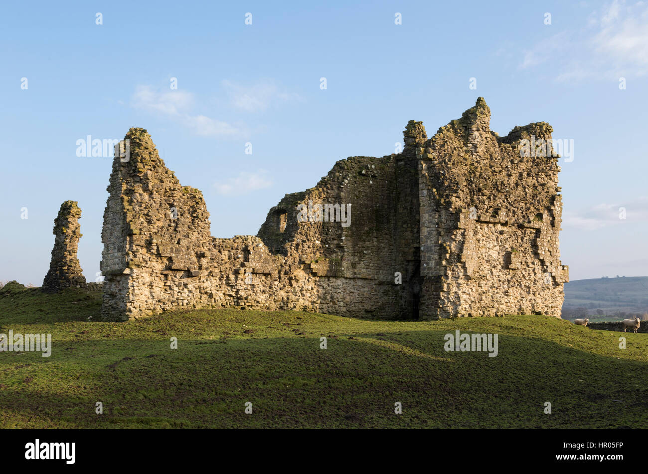 Bewcastle Castle, Cumbria, England - remains of the the west curtain wall and gatehouse. - Stock Image