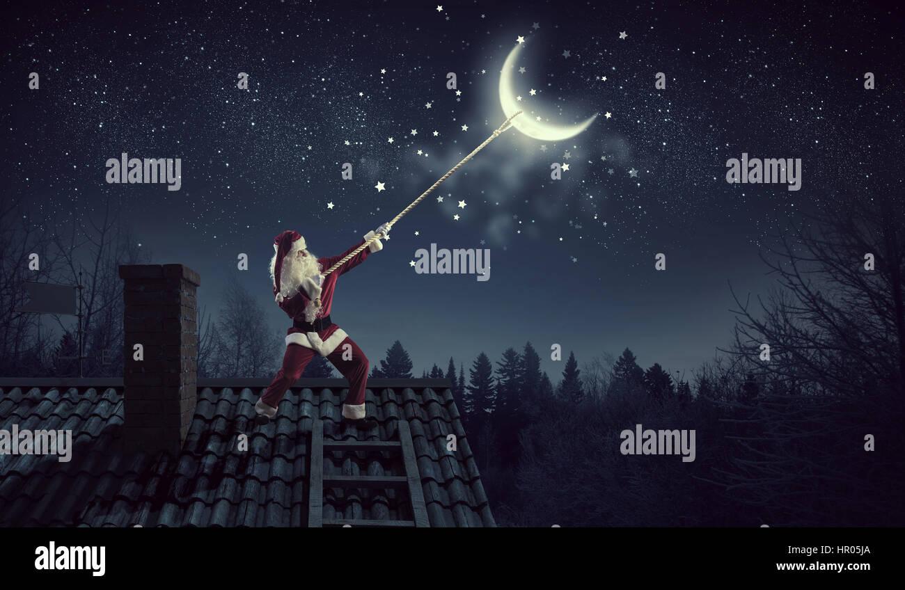 Santa catch the moon    . Mixed media Stock Photo