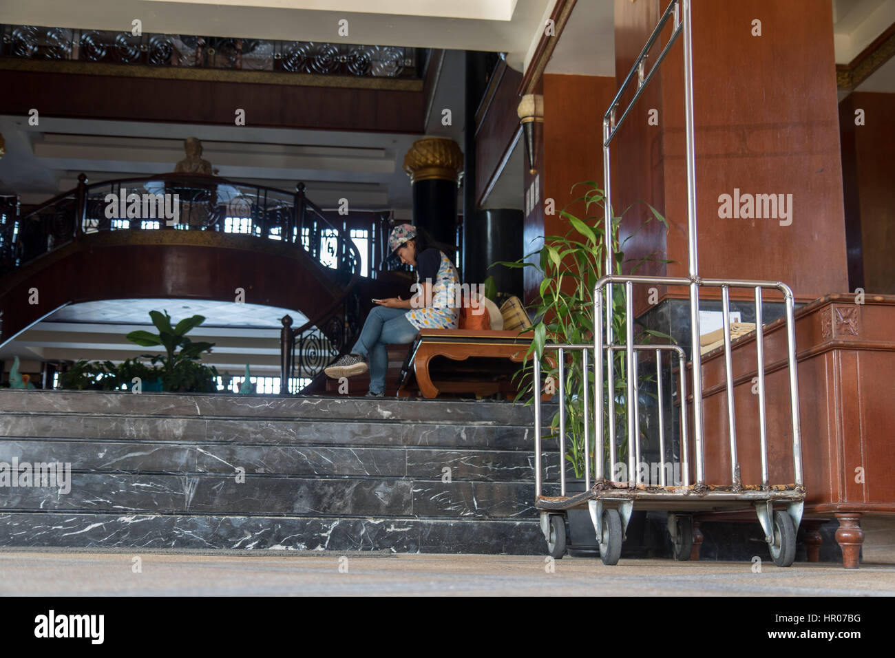 Entrance to the hotel with luggage trolleys - Stock Image