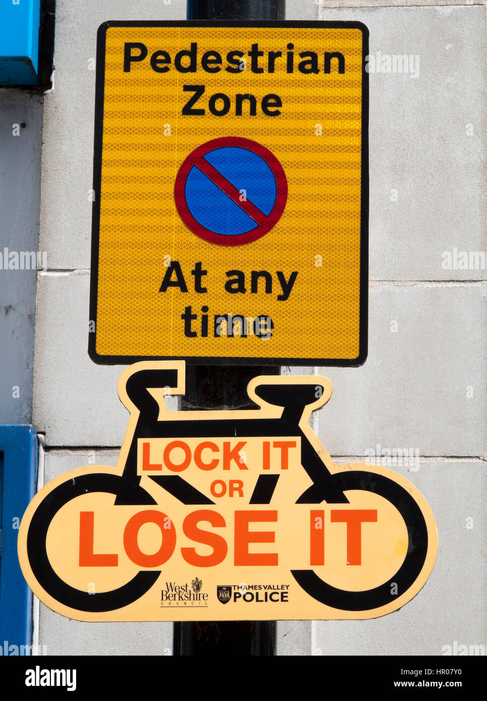 Public information pedestrian sign and Thames Valley Police pushbike lock it sign - Stock Image