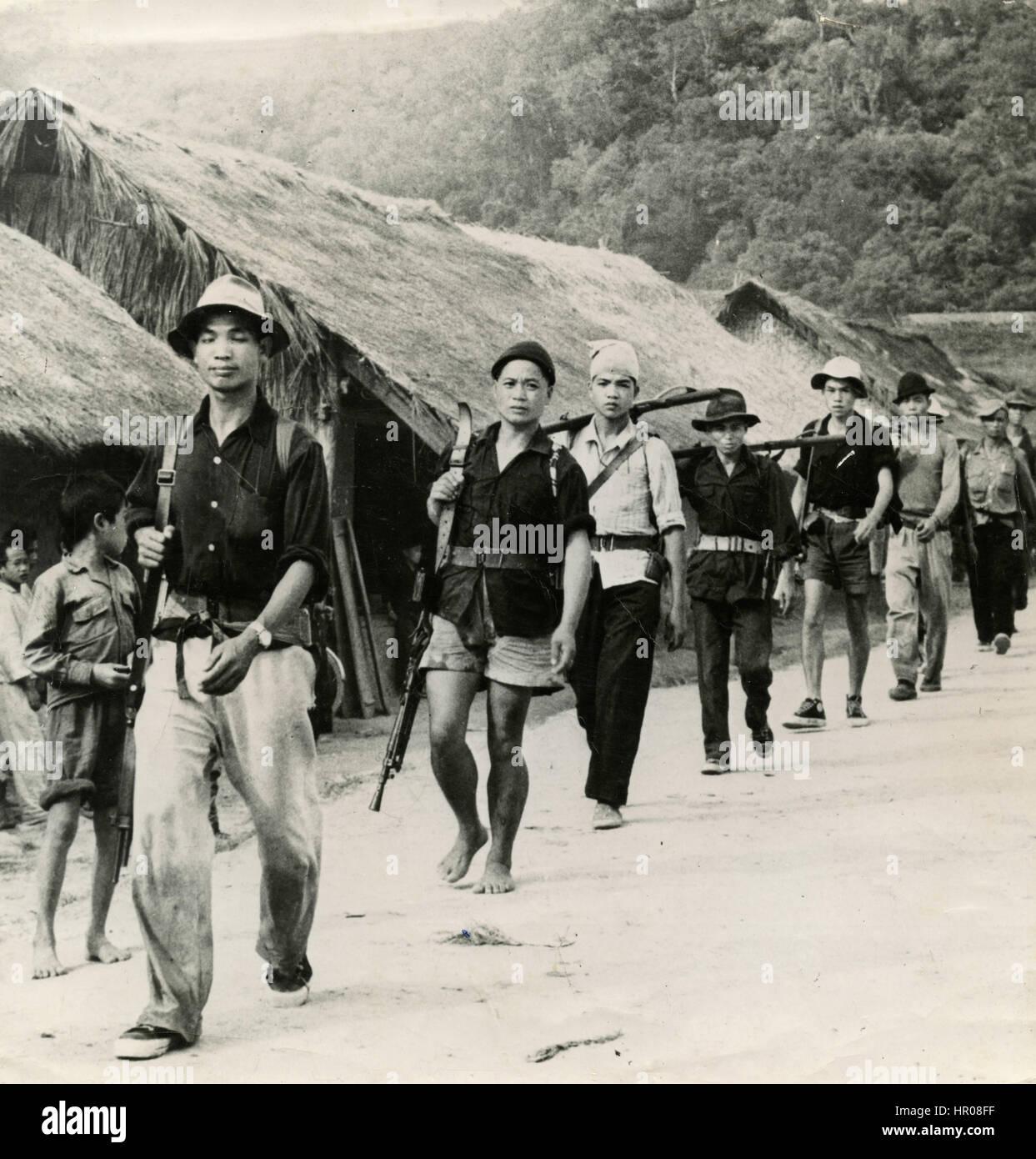 Laotian patrol in a village, Laos - Stock Image