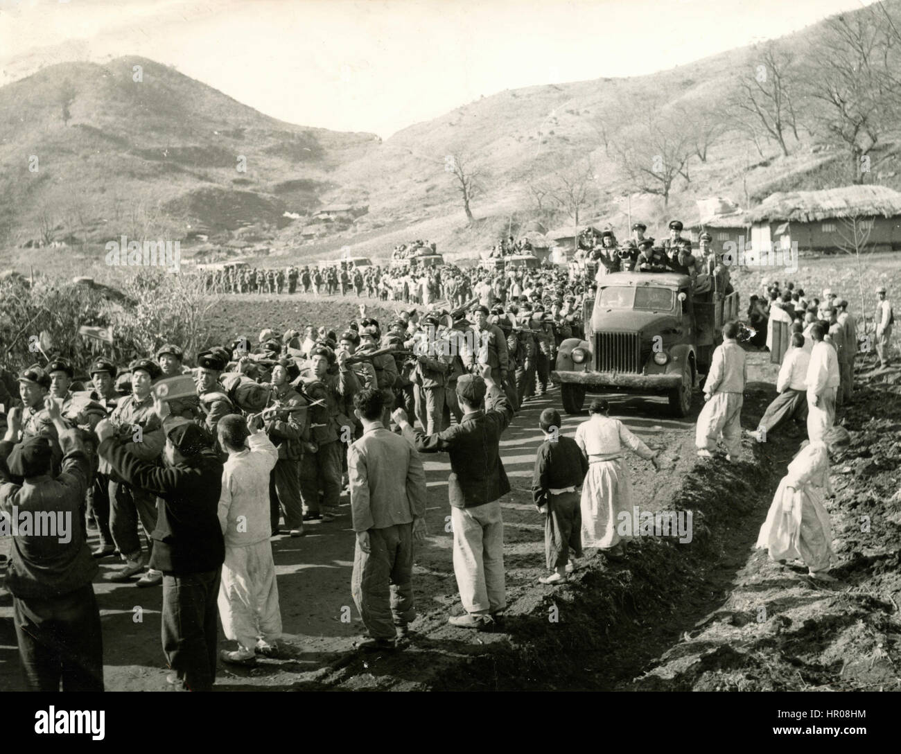 People bidding farewell to departing units of Chinese People's Volunteer Army CPVs, Korea 1958 - Stock Image