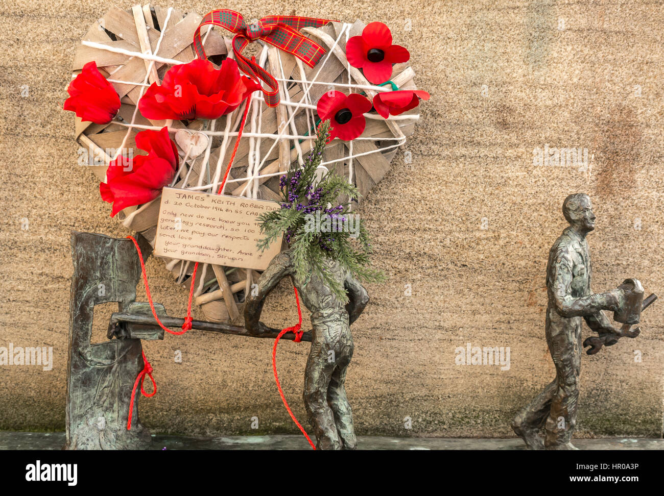 Poignant handmade remembrance heart with poppies and message to lost relative at Scottish Merchant Navy Memorial, - Stock Image