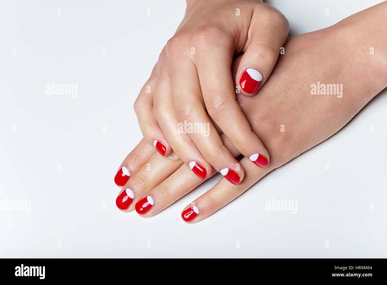 Female hands with red and white nails Stock Photo: 134625516 - Alamy