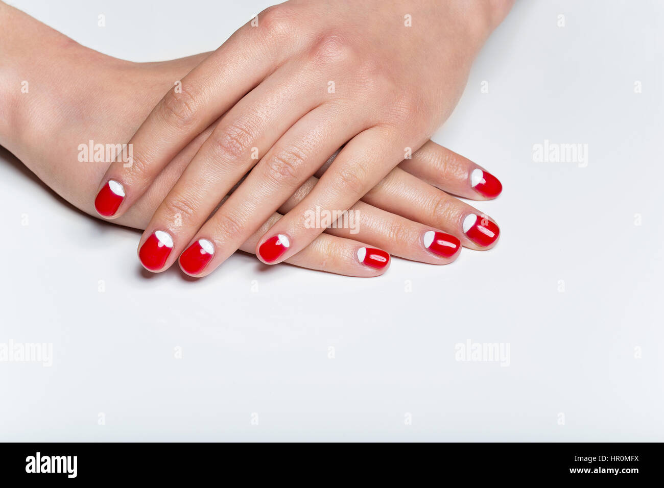 Female hands with red and white nails Stock Photo: 134625790 - Alamy