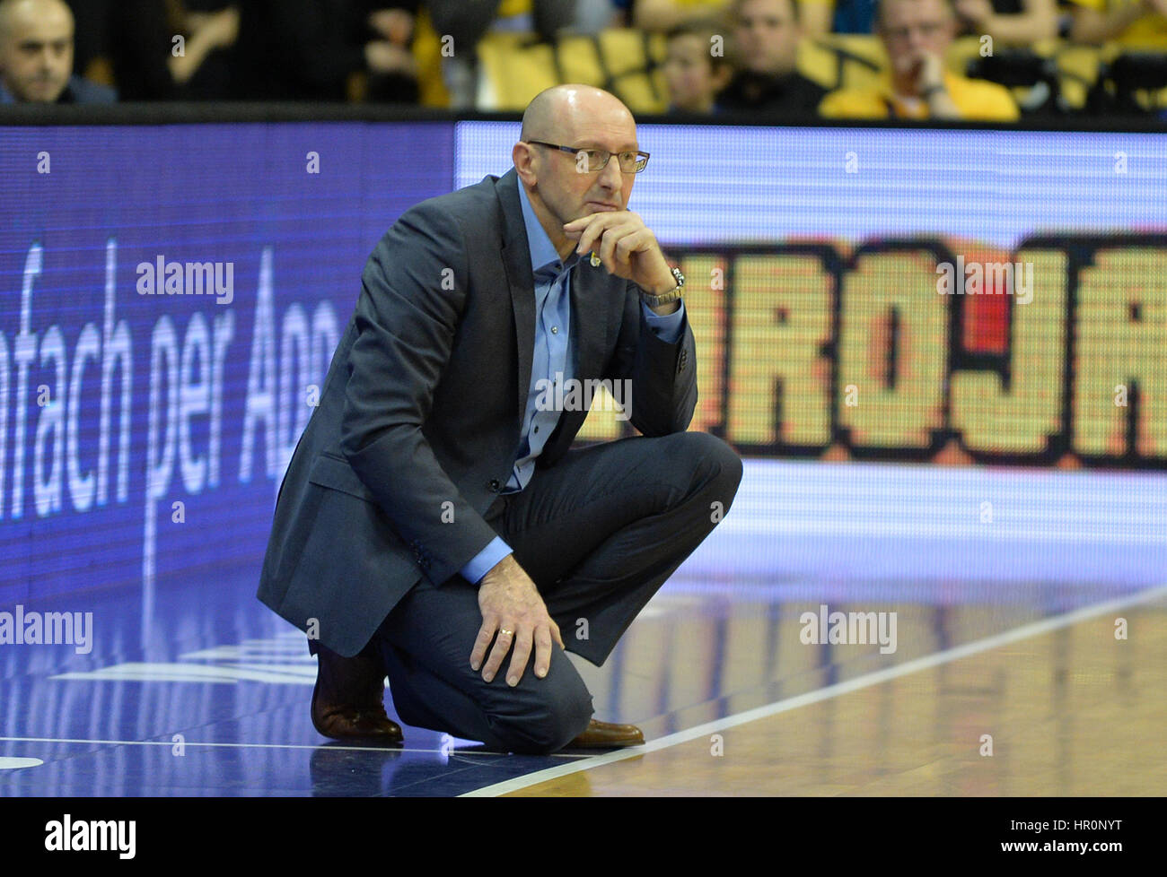 Oldenburg's coach Mladen Drijencic sitting on the sideline during the game between EWE Baskets Oldenburg vs. - Stock Image
