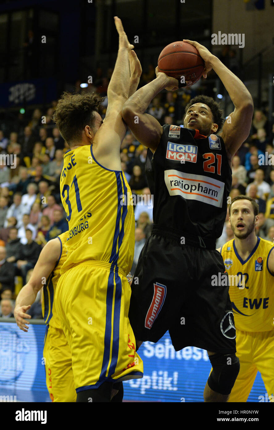 Ulm's Augustine Rubit (r) battles against Oldenburg's Jannik Freese during the game between EWE Baskets - Stock Image