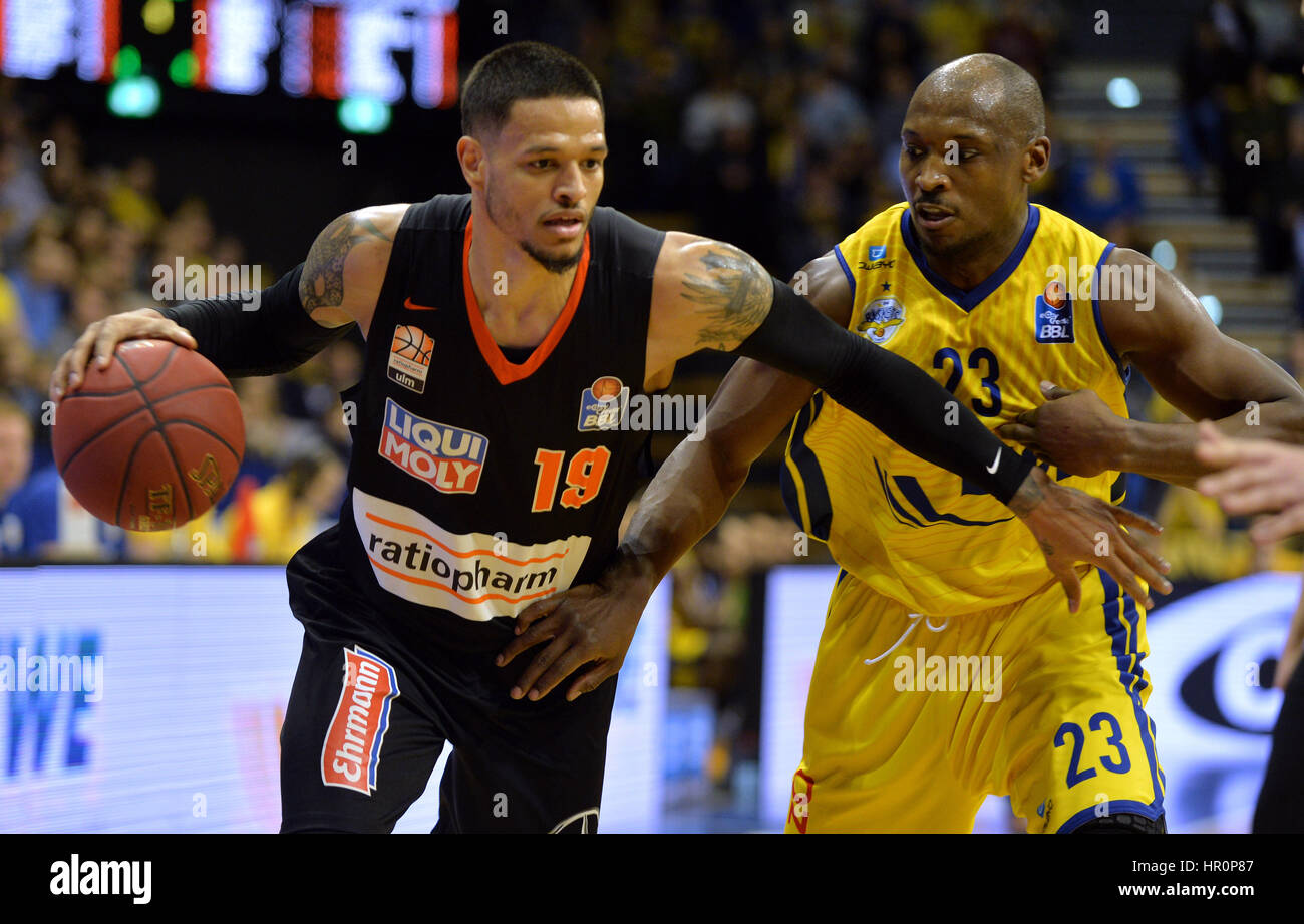 Ulm's Chris Babb (l) in action against Oldenburg's Rickey Paulding during the game between EWE Baskets Oldenburg - Stock Image