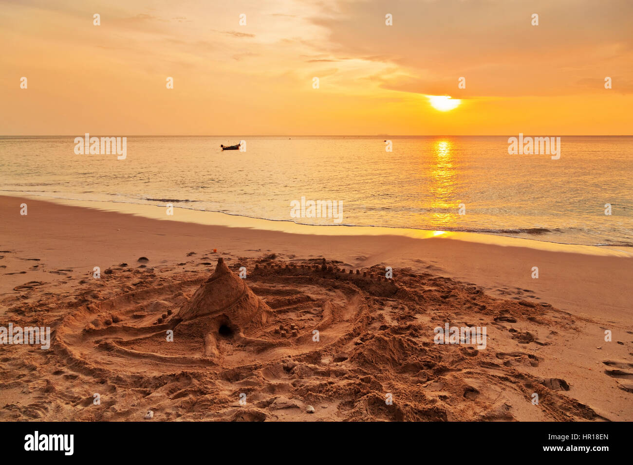Sand castle on the beach at sunset