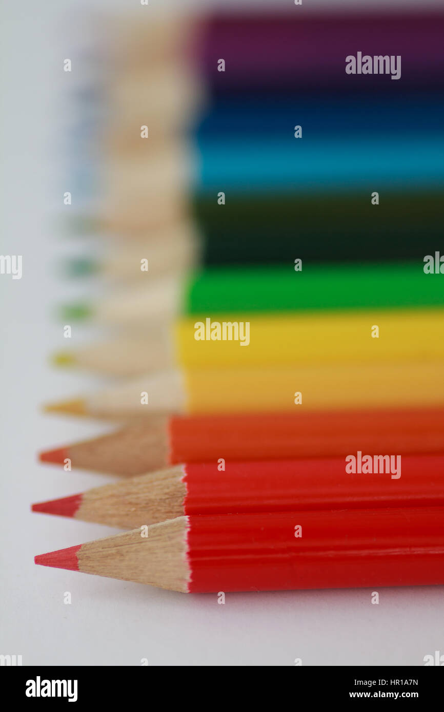 Shallow focus colored pencils with red pencil in sharp focus - Stock Image