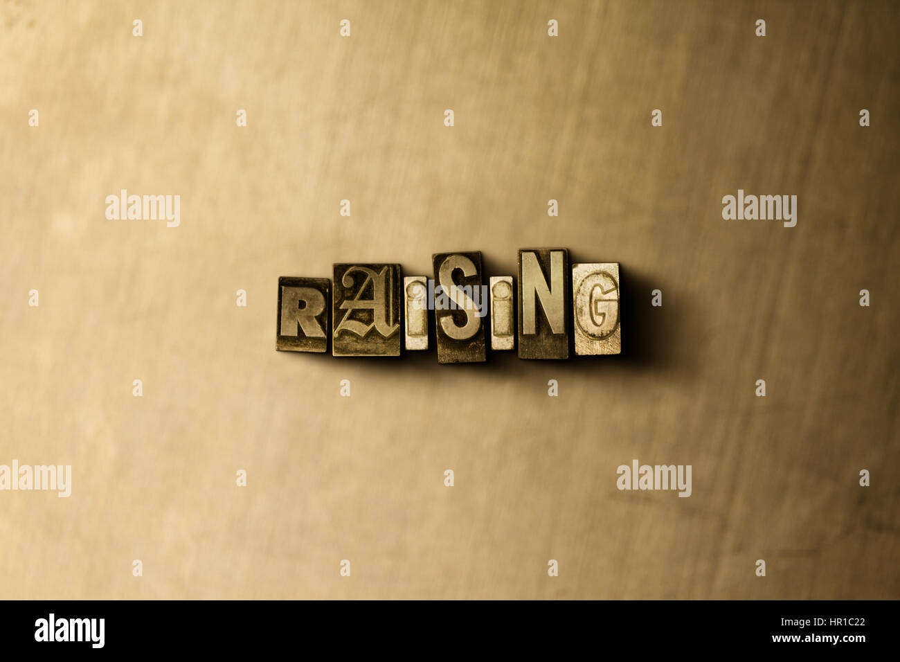RAISING - close-up of grungy vintage typeset word on metal backdrop. Royalty free stock - 3D rendered stock image. - Stock Image