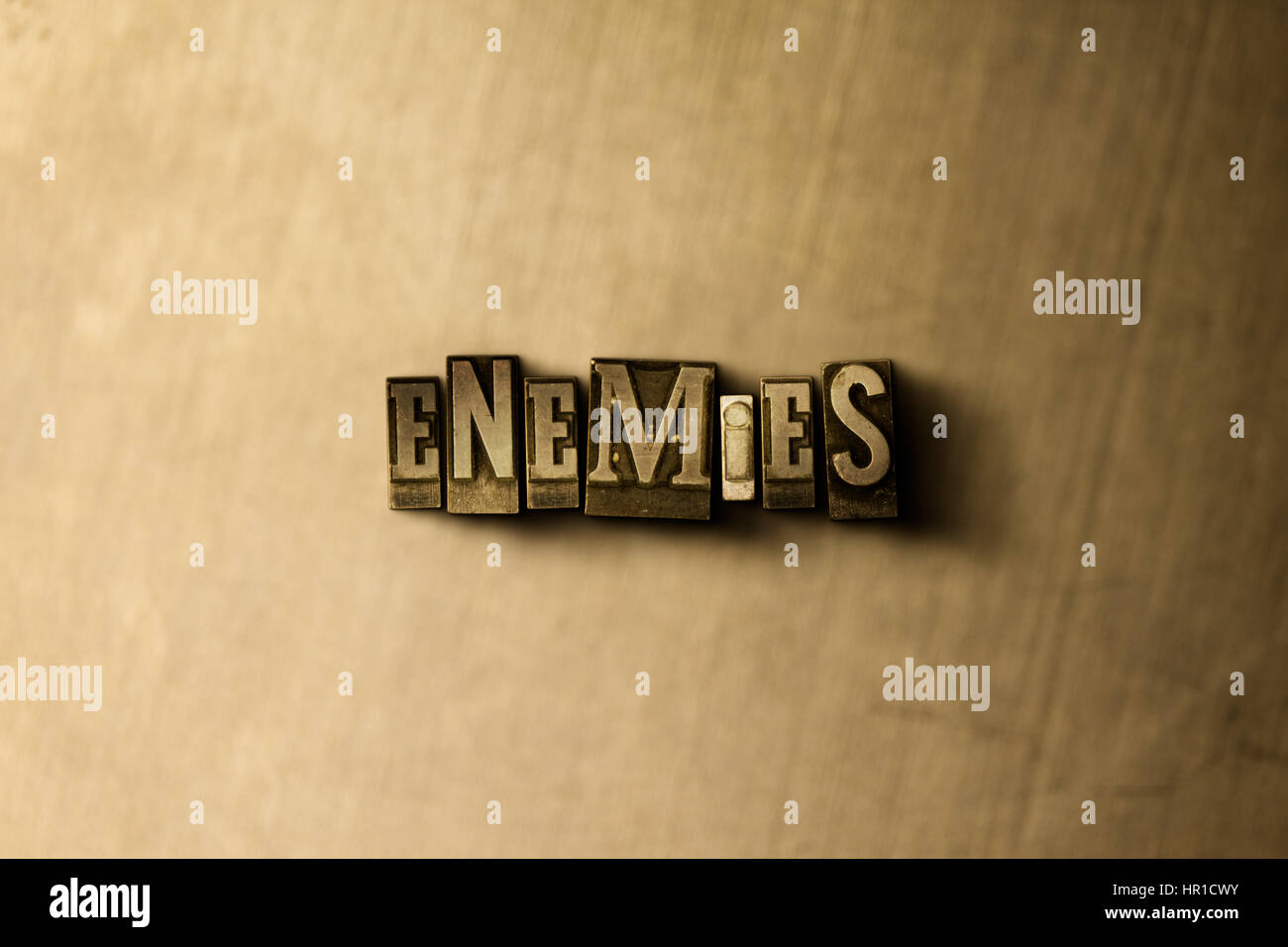 ENEMIES - close-up of grungy vintage typeset word on metal backdrop. Royalty free stock - 3D rendered stock image. - Stock Image