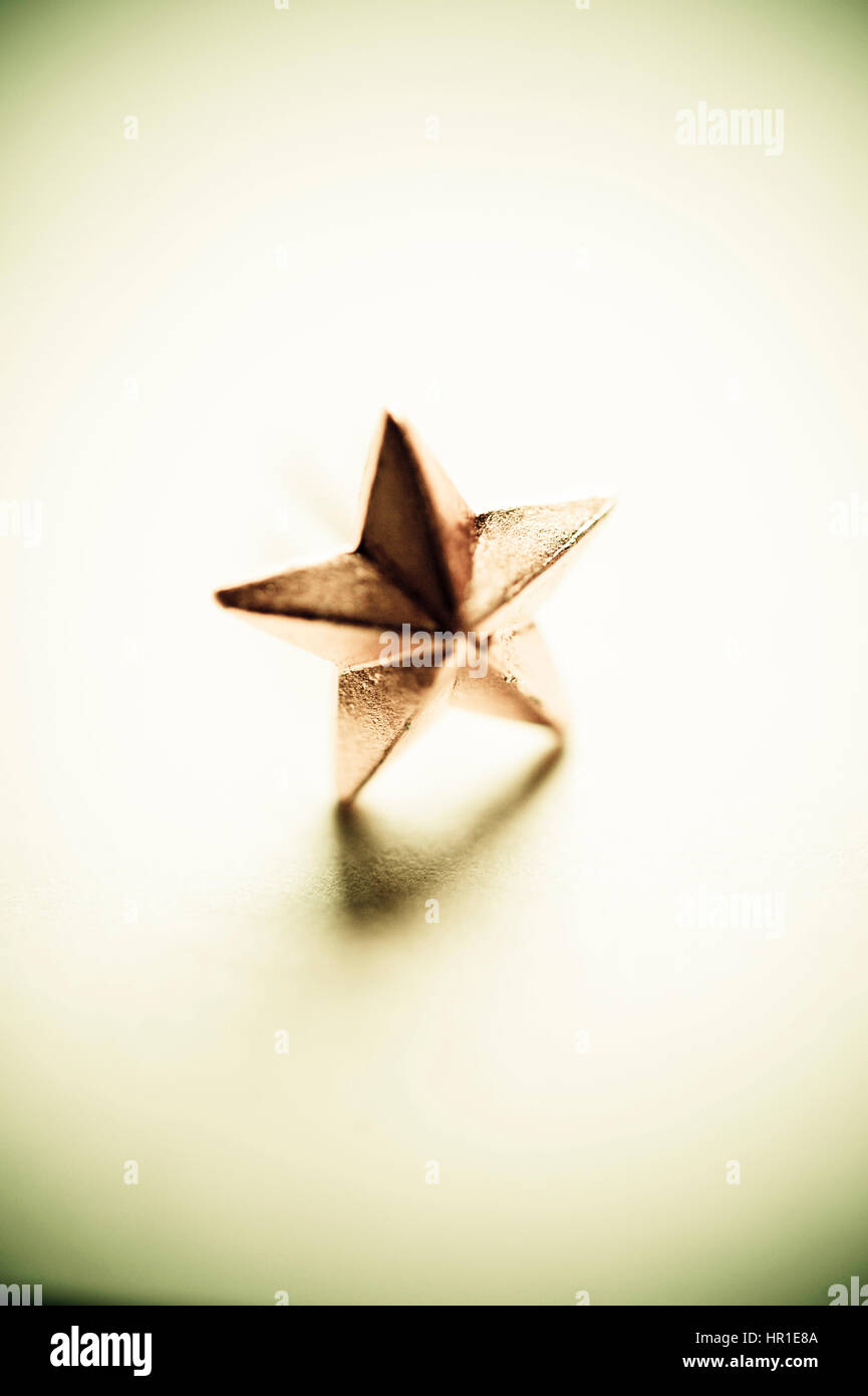 Soviet era golden five-point star, a distinction sign from military shoulder board - Stock Image