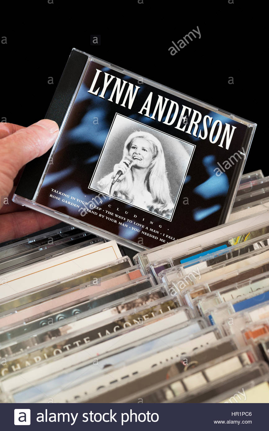 Lynn Anderson CD being chosen from among rows of other CD's. Dorset, England - Stock Image