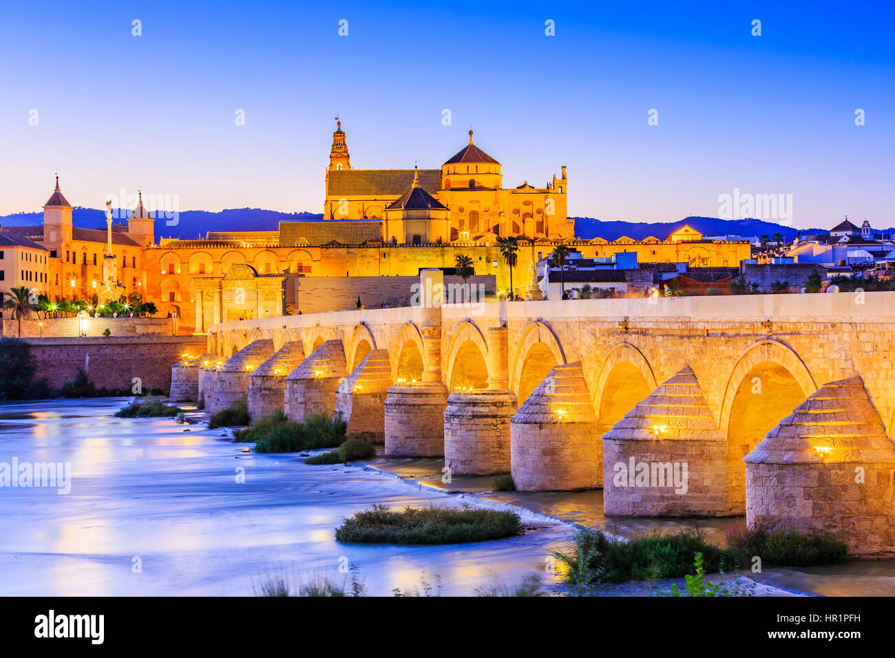 Cordoba, Spain, Andalusia. Roman Bridge on Guadalquivir river and The Great Mosque (Mezquita Cathedral) - Stock Image