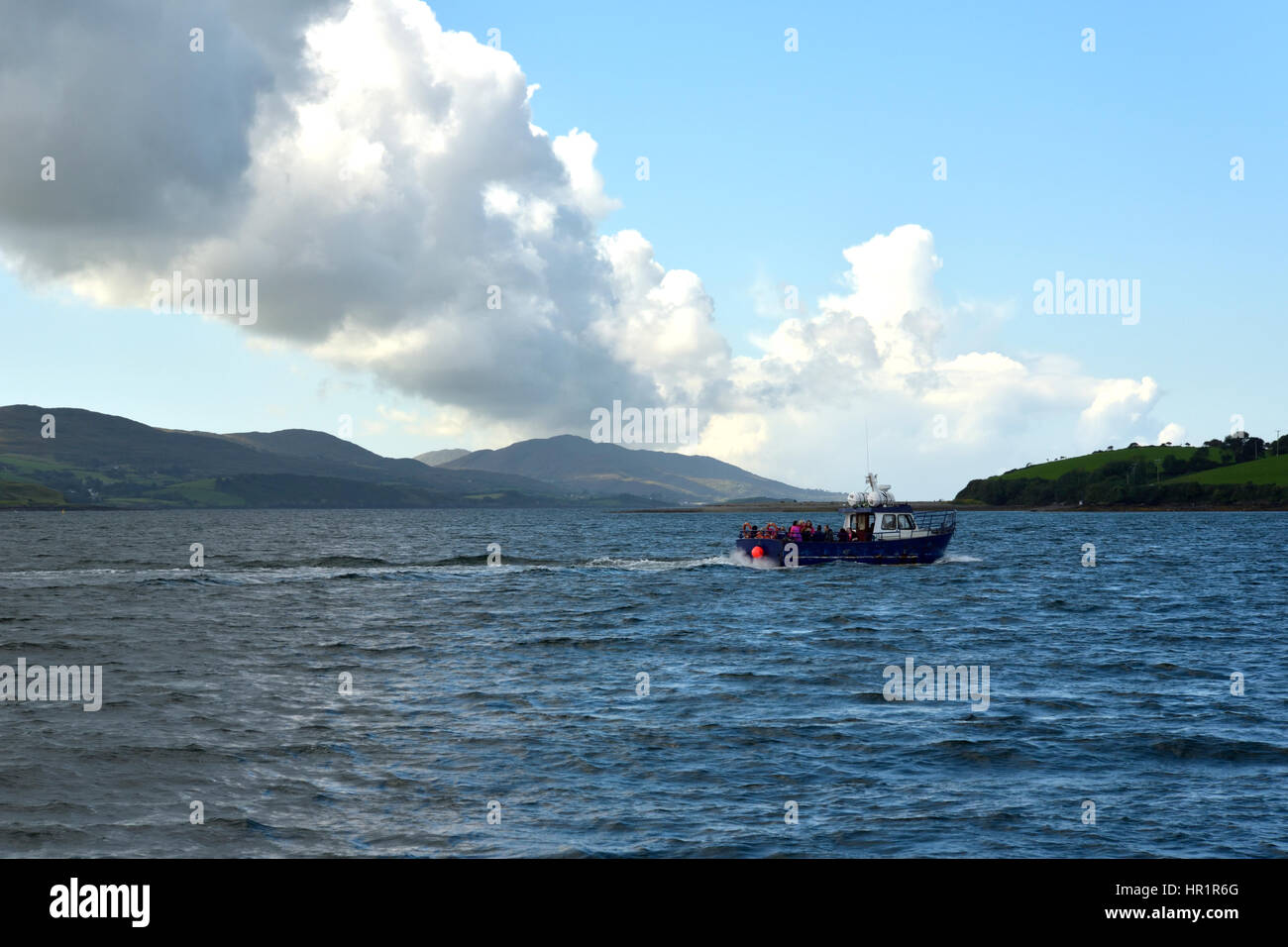 The Whiddy Island Ferry en route to Whiddy with Sheep's Head peninsula in the background Stock Photo