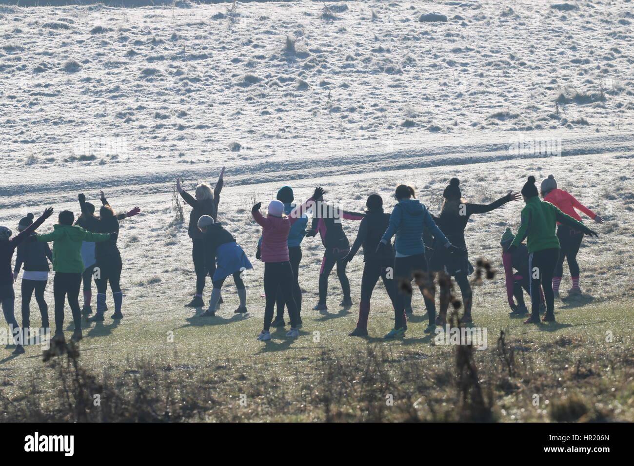 Women Excising up on Wittenham Clumps, UK - Stock Image