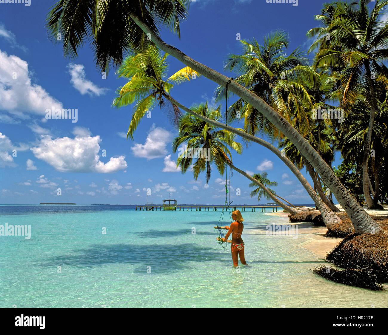 Girl on beach at Kuda Bandos island in the Maldives Republic.. - Stock Image