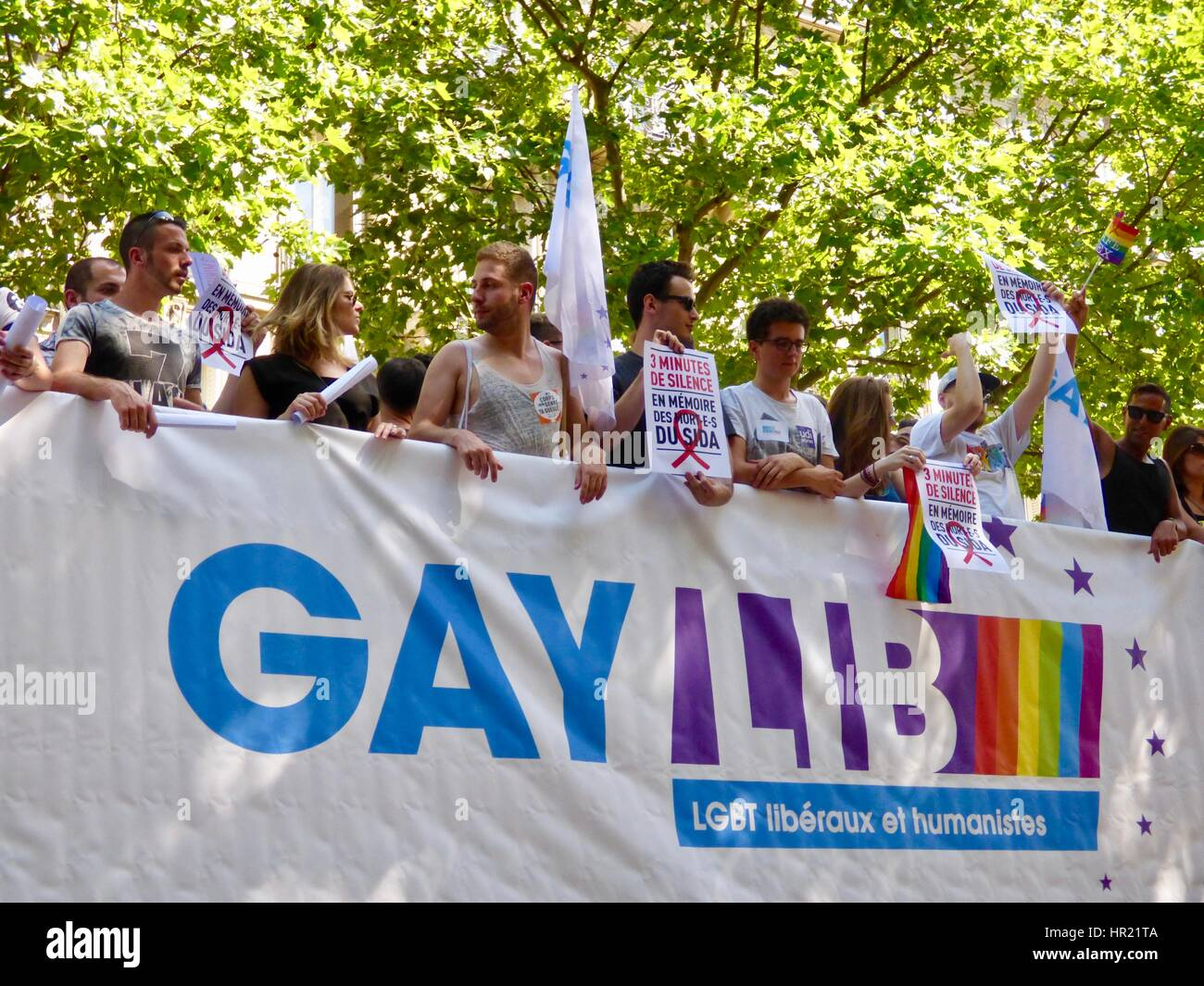 GAYLIB float, Paris Pride Parade 2015. Marche des Fiertés. Participants hold signs during moment of silence - Stock Image