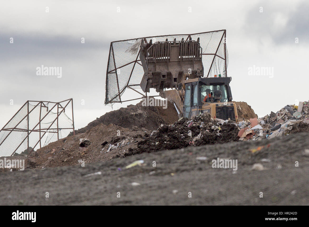 Workmen   at Milton landfill site near Cambridge continuing to prepare the ground for the police search of missing - Stock Image